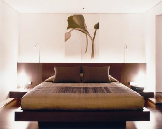 a beautiful zen bedroom with a dark Asian minimalist bed and nightstands, dark bedding and a lovely floral artwork