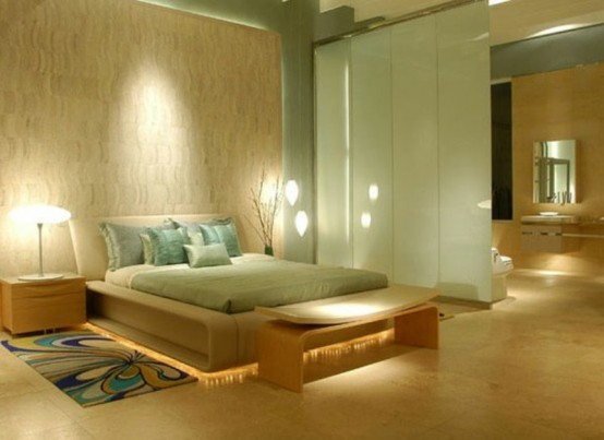 a neutral and pastel bedroom with a zen feel, Asian style neutral furniture of wood, a wood wall, pastel green bedding, a green sliding door and some lights