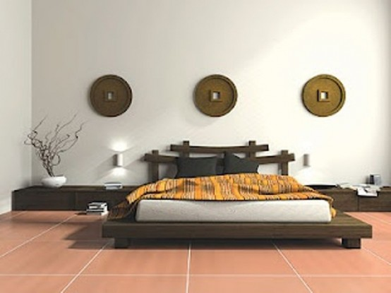 a zen-inspired Asian bedroom with low wooden furniture in Asian style, neutral bedding, branches and decorative plates on the wall