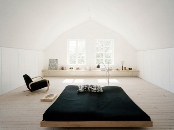 A Minimalist Zen Bedroom With Plenty Of Natural Light, A Wooden Bed And A Chair, A Storage Unit By The Window Is Very Beautiful