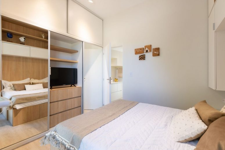 The Bedroom Shows Off Much Hidden Storage Space, A Comfy Bed And Some Lights - Who Needs More In Such A Space