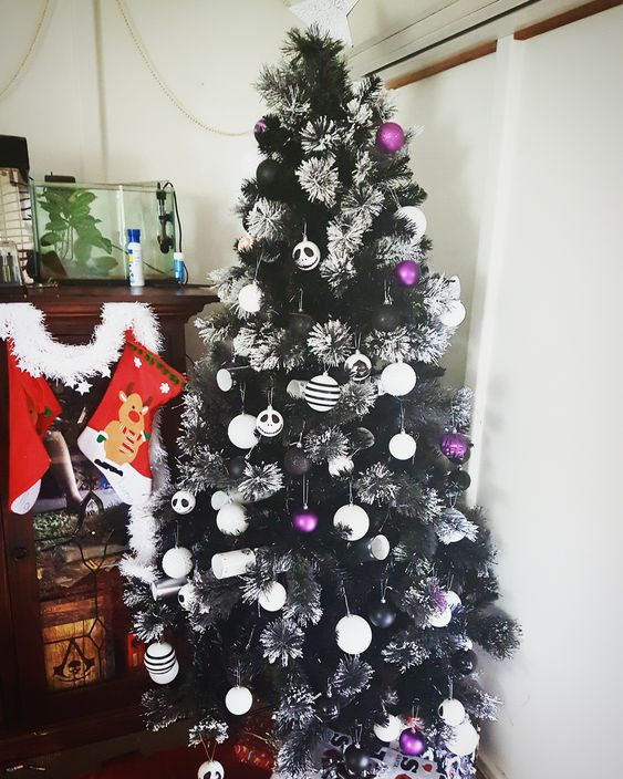 A Beautiful Flocked Black Christmas Tree With White And Purple Ornaments Plus Jack Skellington Ones Is A Bright And Contrasting Idea To Rock