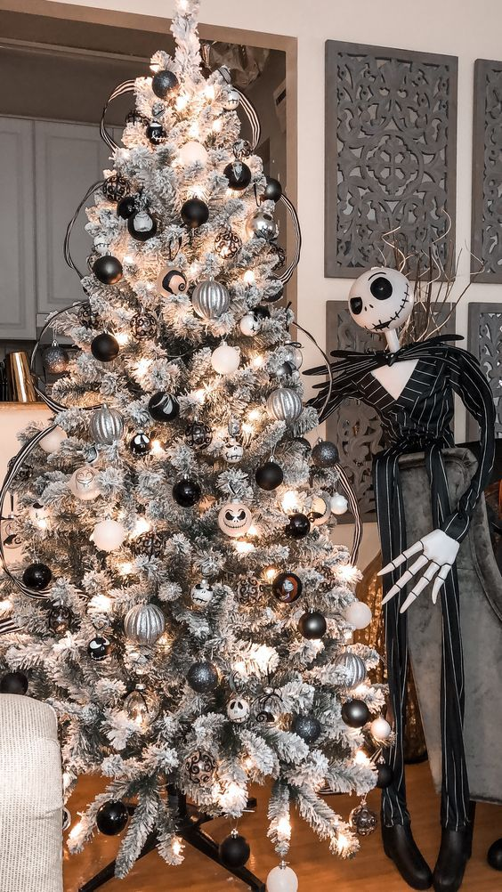 A Beautiful Grey Christmas Tree With White, Black And Silver Ornaments, Jack Skellington Ones And His Figure Next To The Tree
