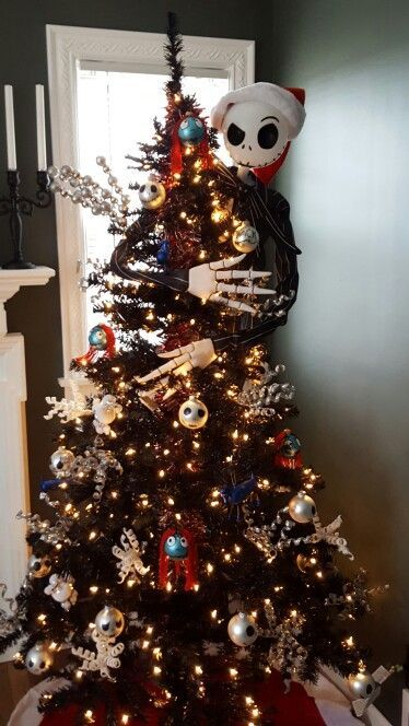 A Black Halloween Tree Decorated With Lights, Skulls, Snowflakes And Jack Skellington Embracing It For Tim Burton Fans