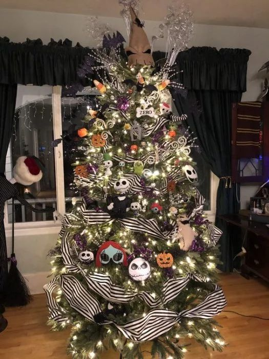 A Christmas Tree With Lights, Nightmare Before Christmas Ornaments, Striped Ribbons, Shiny Branches And Twigs And A Hat On Top