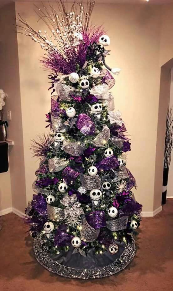 A Christmas Tree With Silver And Purple Ribbons, Jack Skellington Ornaments, Twigs And Beads And Shiny Ornaments Is A Statement