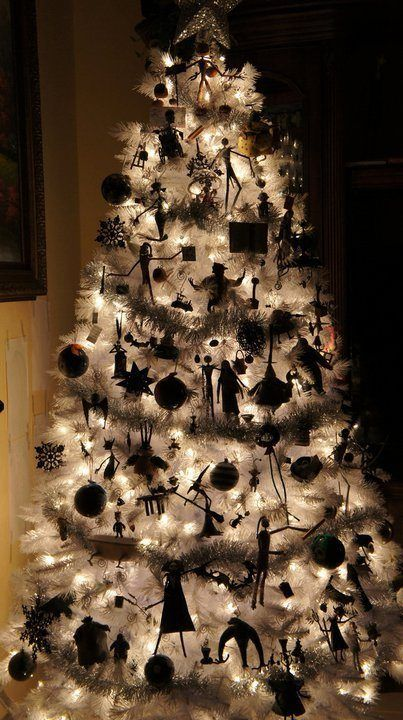 A Lit Up White Christmas Tree With Nightmare Before Christmas Ornaments And Garlands Is A Lovely Idea