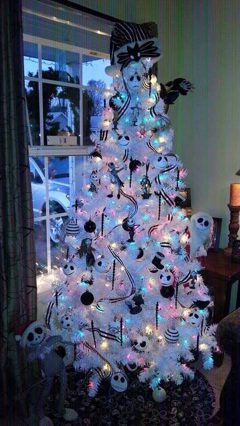 A White Christmas Tree With Colorful Lights, Black And White Ribbons And Ornaments, Jack Skellington Ones, Bows And Garlands