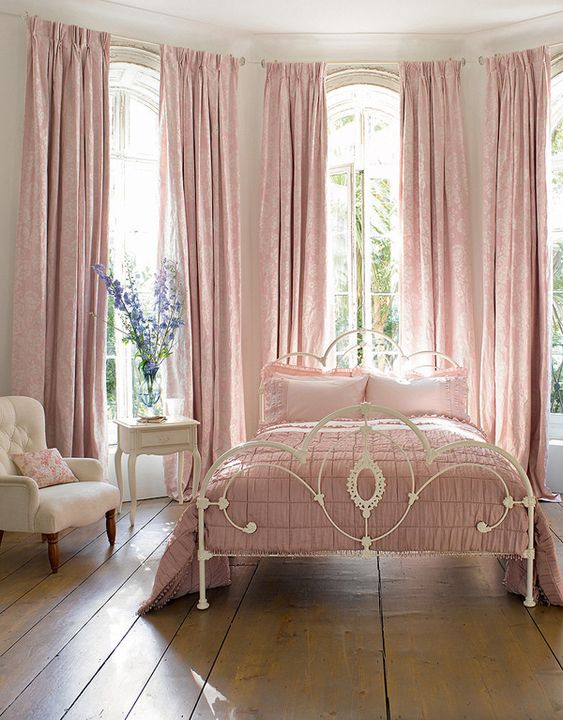 a vintage feminine bedroom with elegant white furniture, pink linens and textiles and nothing else is beautiful