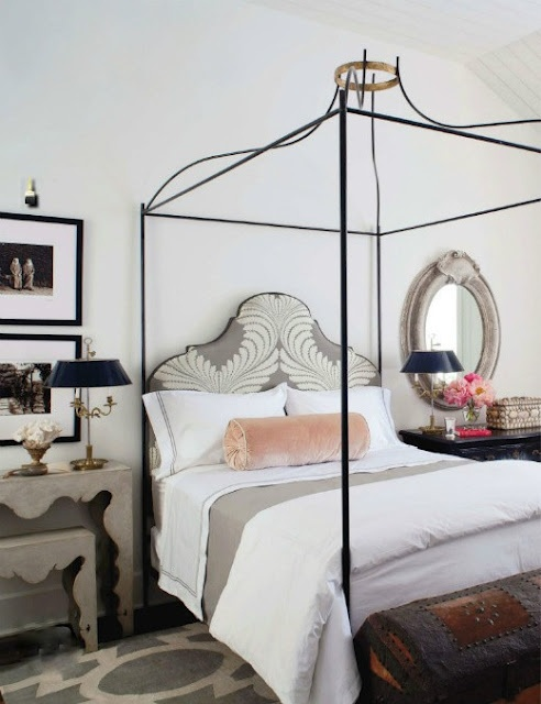 a chic and romantic vintage bedroom with elegant furniture, white and pastel textiles, floral upholstery and some lamps is beautiful