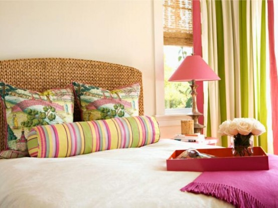a colorful feminine bedroom with a woven bed, bright pillows and curtains, bright bedding and a pink lamp is cheerful and welcoming