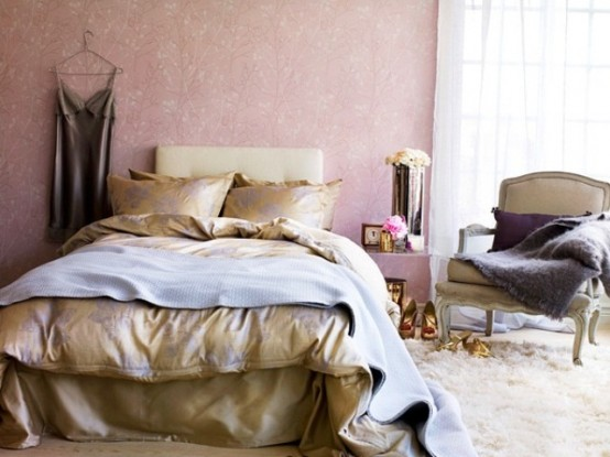 a chic and beautiful feminine bedroom with pink wallpaper walls, elegant furniture, floral bedding and a fluffy rug on the floor
