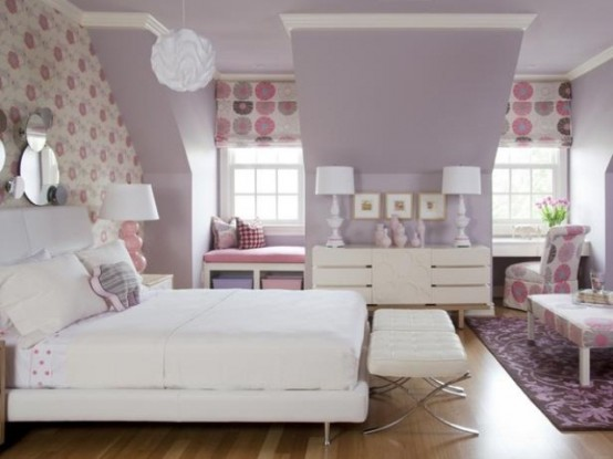 a lavender attic bedroom with an accent wallpaper wall, printed Roman shades, modern furniture and mirrors and artworks