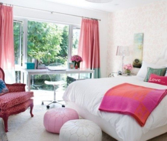 a colorful contemporary bedroom with a pink chair, ottoman, blanket and color block curtains and bright touches to the white backdrop is wow
