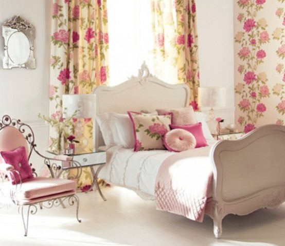 a bright vintage bedroom with refined neutral furniture, floral and bright pink textiles, a chic mirror and a mirrored nightstand is amazing