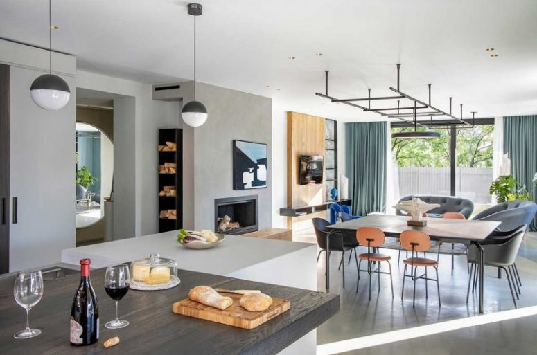 The dining zone continues the space, and there's a built-in fireplace to cozy it up