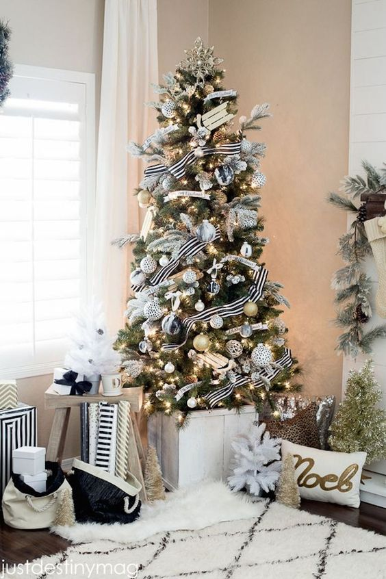 A Chic Christmas Tree With Lights, White, Black And Gold Glitter Ornaments And Striped Ribbons Is A Very Bright And Cool Idea