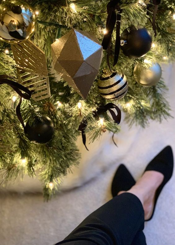 A Gorgeous And Elegant Christmas Tree With Lights, Gold And Black Ornaments Of Geometric Shapes And With Various Patterns