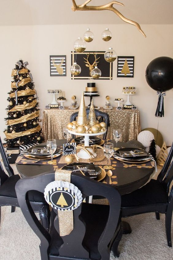 A Modern And Bold Black And Gold Christmas Decor With A Bright Tree, Balloons, Hanging Ornaments And A Chic Tablescape With Printed Placemats