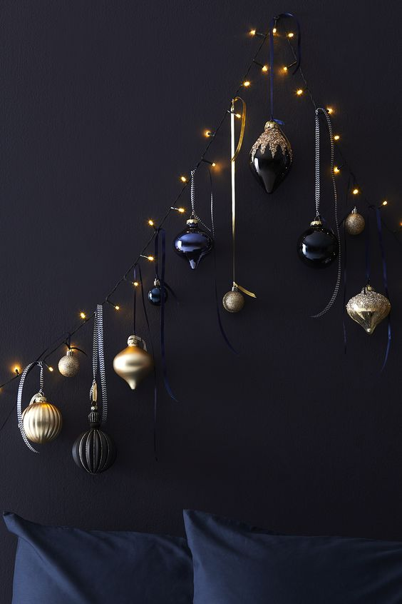 A Unique Christmas Tree Of Lights And Black, Navy And Gold Ornaments Hanging On Them Is A Lovely Space-Saving Idea