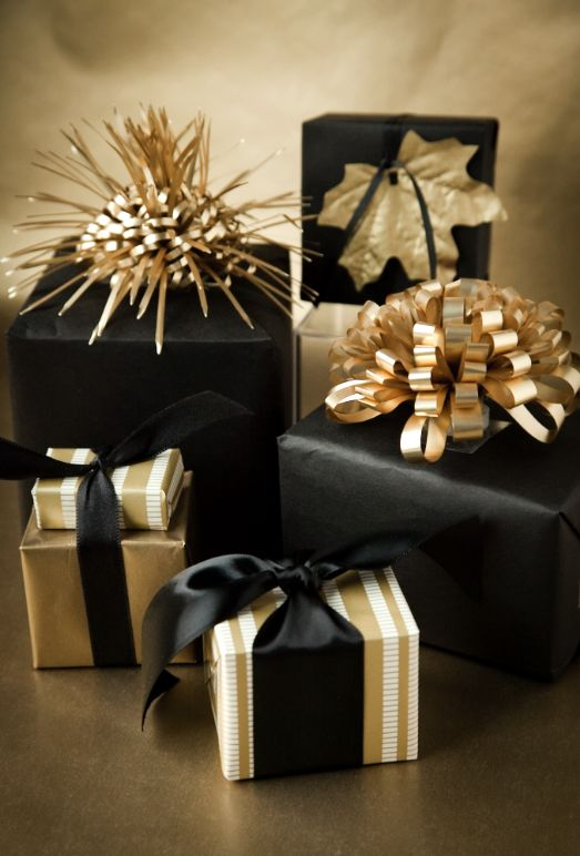 Black And Gold Christmas Gifts With Bows On Tops Are Amazing For Christmas And Nye And Look Very Festive And Bold