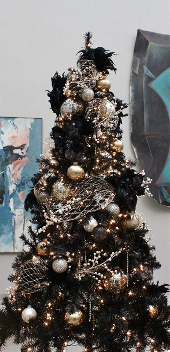A Black Christmas Tree With Lights, Glam Metallic Ornaments, Black Feathers And Metallic Nets Is A Lovely And Chic Idea