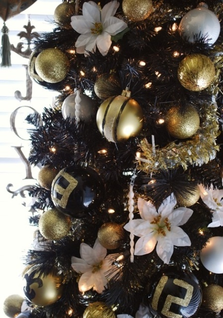 Gorgeous Glam Blakc, Gold Glitter And White Christmas Tree Decor With Lights, Fabric Blooms, Beads And Icicles Is A Lovely And Bold Idea