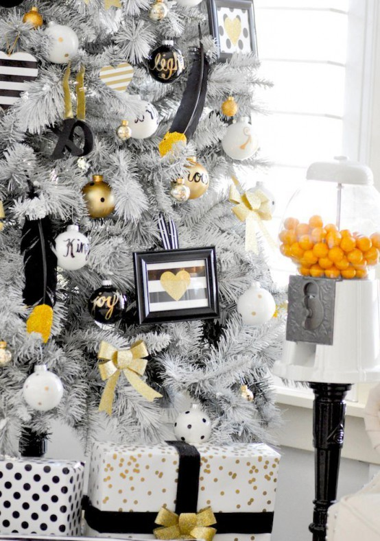 A White Christmas Tree With Black, White And Gold Ornaments, With Signs, Calligraphy And Feathers Is A Lovely Glam Idea For Winter Holidays