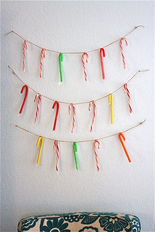 twine with colorful candy canes is a fun and bright idea of Christmas or holiday decor to rock and it can be easily done yourself