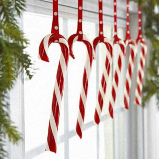candy cane window decor with fir branches is a chic and lovely idea for whimsical and fun Christmas decor