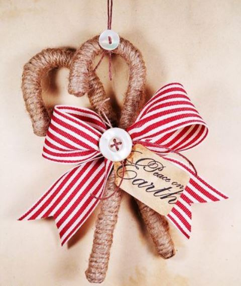 classy rustic Christmas ornaments - candy canes wrapped with twine, with buttons and a striped bow are amazing