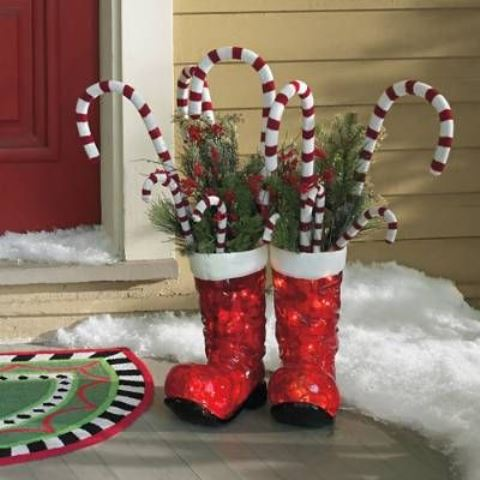 red boots with fir branches, berries and candy canes are amazing Christmas decor with a slight fun touch