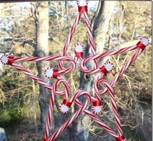 en edible Christmas decoration of candy canes and peppermints shaped as a star is a lovely idea for indoors and outdoors