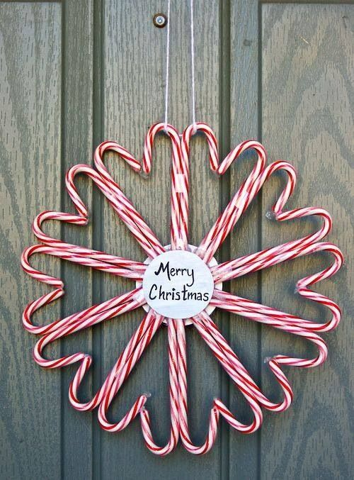 a large candy cane wreath with a tag inside is a very fun and easy decor idea for the holidays