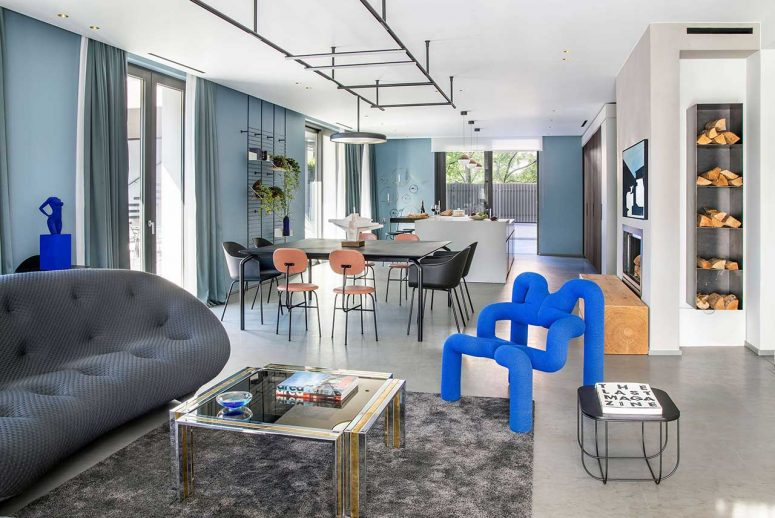 This unique home is done in a color palette of grey and blues, with bold electric blue touches that will make your jaw drop