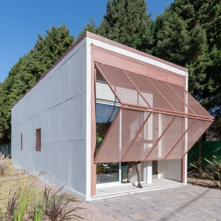 This Small Prefab Home Features A Large Folding Screen That Is A Layer Of Protection To The House