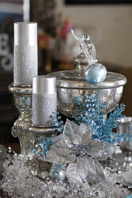 refined silver and blue Christmas decor with beads, silver candles in candleholders, blue branches and ornaments is very refined