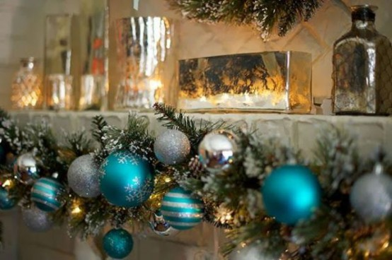 a garland with silver and tiffany blue ornaments and lights is a pretty decoration for indoors and outdoors