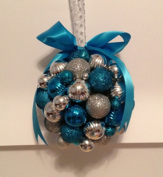 a Christmas decoration of silver and tiffany blue ornaments plus a blue bow on top is a chic idea you can easily make yourself