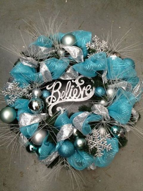 a pretty silver and tiffany blue Christmas wreath of ribbons, ornaments, twigs and snowflakes