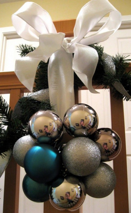 a lovely Christmas decoration of silver, grey and blue ornaments, a large white ribbon bow can be used both inside and outside