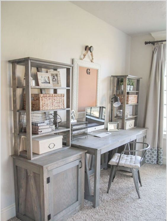 a vintage farmhouse home office with a wooden desk, cabinets and open shelves on them and a board in a frame