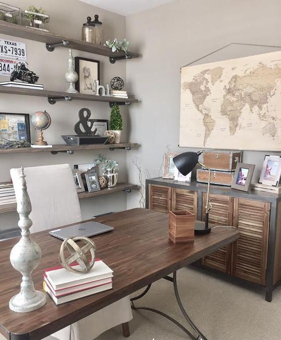 an industrial farmhouse home office with open industrial shelves, a wooden desk, a shutter door storage unit, vintage decor and monograms