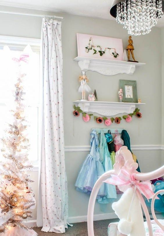 a beautiful silver Christmas tree decorated with silver and white ornaments is a lovely idea for a kid's room