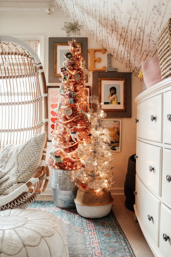 a duo of Christmas trees with lights and various ornaments and decor is a perfect idea for pulling off holiday decor in your kids' room