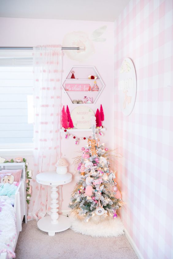 a lovely flocked Christmas tree with pink and blush ornaments, small hot pink tinsel trees will help to create a mood here