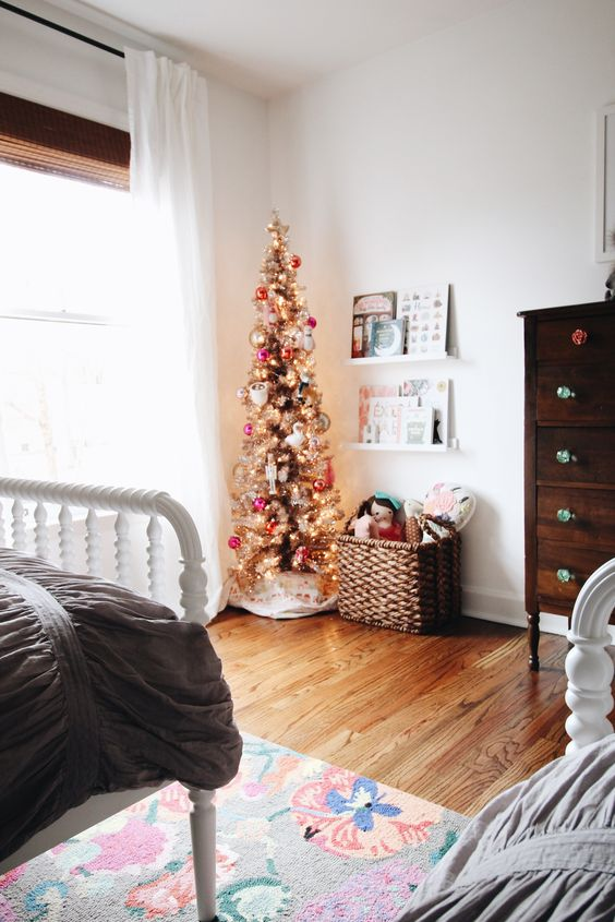 a gold Christmas tree with colorful ornaments is all you need to create a feeling of holidays in your kids' room