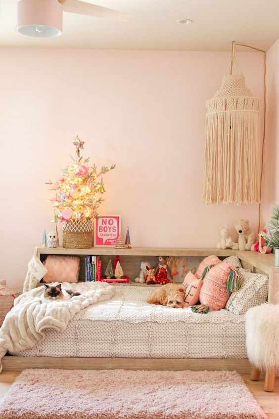 a small flocked Christmas tree with lights and pastel ornaments is a cool and easy solution to bring a feeling of holidays to the room