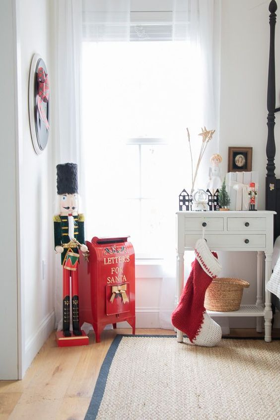 a red stocking, a red box for letters to Santa and a vintage toy for creating a holiday atmosphere in the space
