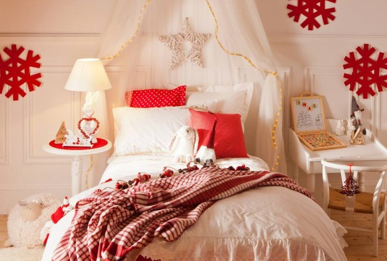 lights and oversized ornaments attached to the frame, pretty Christmas bedding and a fun marquee light sign for a holiday feel